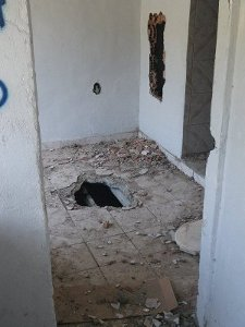 House with holes on the floor and the walls, damaged by City workers