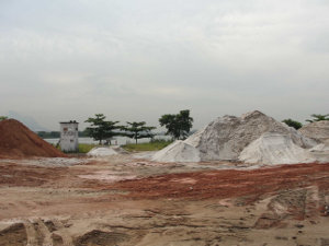 Mounds of dirt for filling in part of the Lagoa de Jacarepaguá