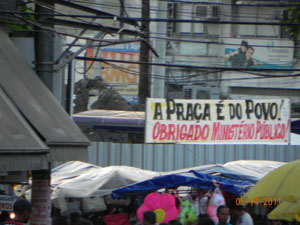 "A banner saying ""The Square belongs to the people"""