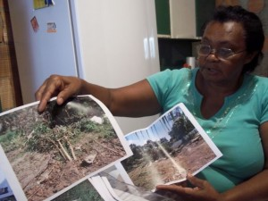 Dona Rita with pictures of the garden