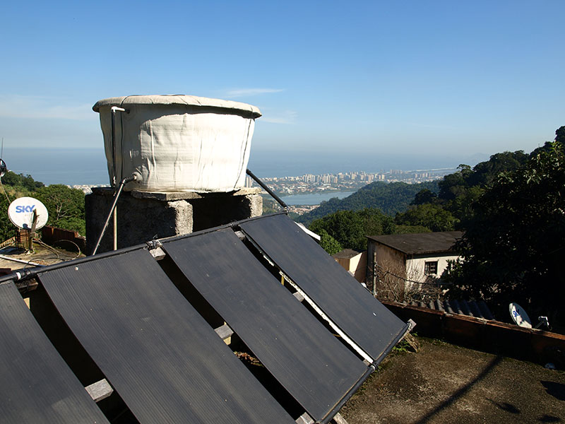 Solar panels on the roof of a resident's home are used to heat water. There are hopes to expand this project to more homes in the community.