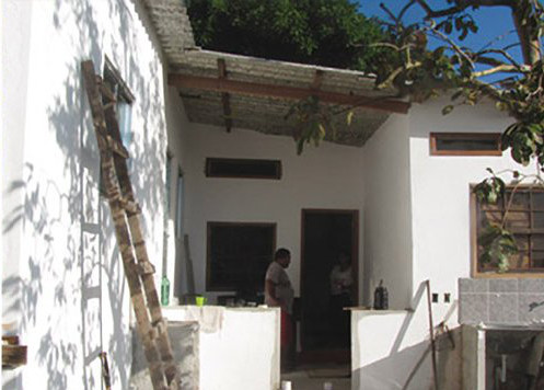 The house after Family Architect's work. Photo by Soluções Urbanas