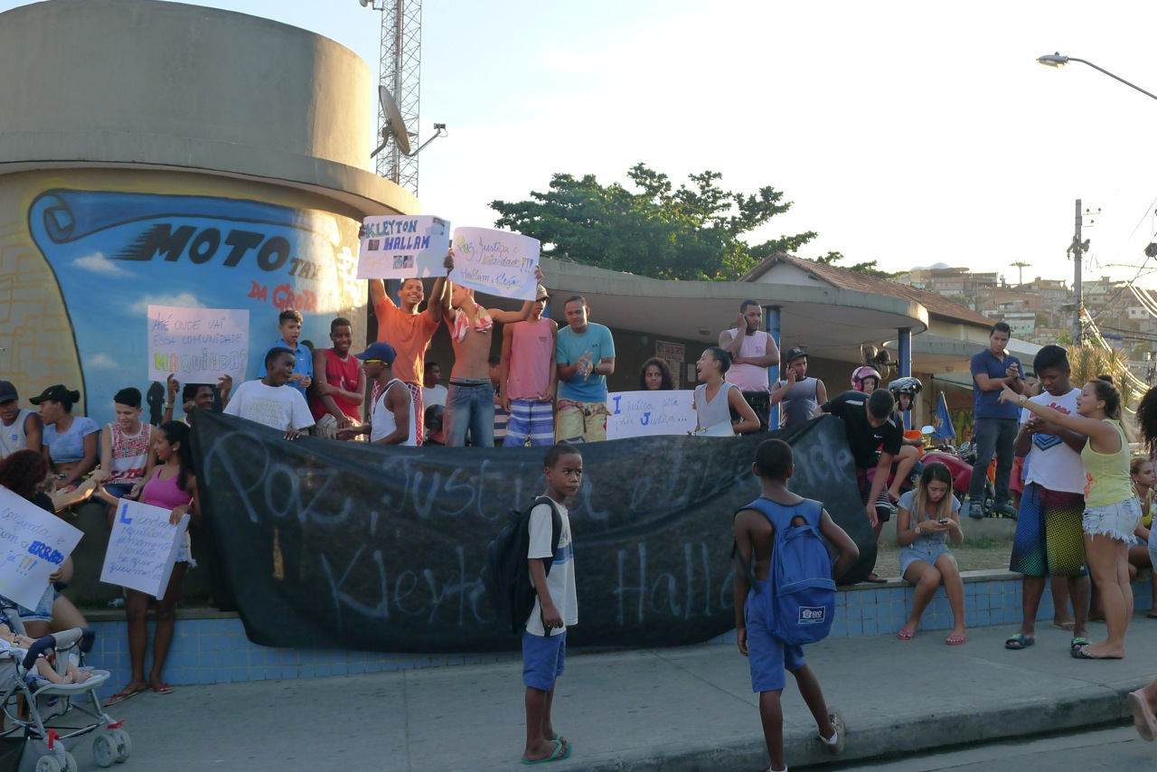 Young people protest the arrest of two boys from the community. Photo by Charlotte Livingstone