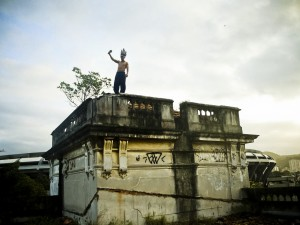 An member of the Aldeia Maracanã occupation atop the former Indigenous Museum. Photo by Mídia NINJA
