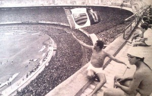 A Flamengo supporter waves the flag over a packed Maracanã