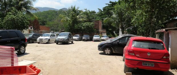 Vila Autódromo demolished lots now used as parking for Olympics construction workers.