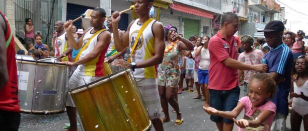 Unidos do Complexo do Alemão walking through Nova Brasília in an act of resistance. Photo: Charlotte Livingstone