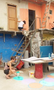 Activists renovate a space Saturday at the ReintegraAÇÃO event in Complexo do Alemão.