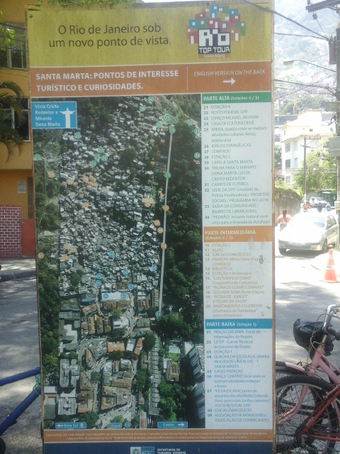 """Rio de Janeiro from another point of view"" – the information board of Rio Top Tour shows a list of the 34 touristic points of the favela. Corumbá Square, Santa Marta in Botafogo. Photo by Miriane Peregrino"