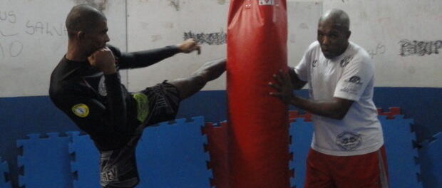 Martial arts teacher Zé Milton trains with Penca.