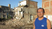 Lélio Fernandes stands in front of his half-demolished house