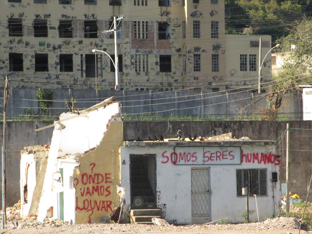 "Graffiti reads ""We are human"" and ""Where will we worship?"""