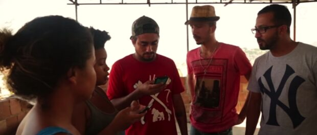 Coletivo Papo Reto use smartphones to live-stream videos of news and police actions