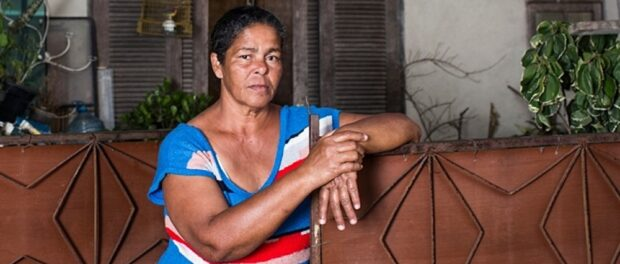Guardian caption: Jane Nascimento de Oliveira, who is one of hundreds of residents fighting to save their homes from forced eviction for the 2016 Olympics, in Barra da Tijuca, Rio de Janeiro, Brazil. Photo by Lianne Milton/Guardian