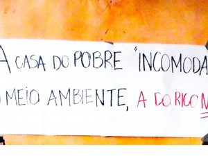 """The poor person's house 'hurts the environment.' The rich person's does not."" Photo by Carol da Luz"