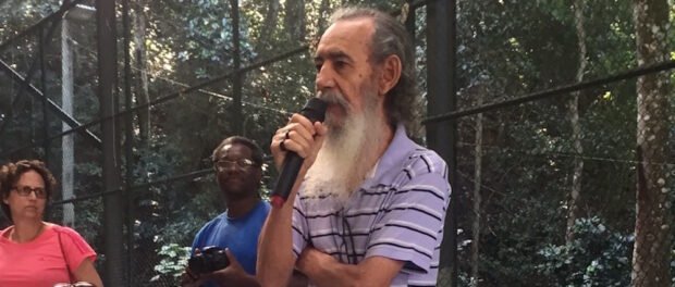 Sr. Martins, Rocinha leader and activist, speaks at the event