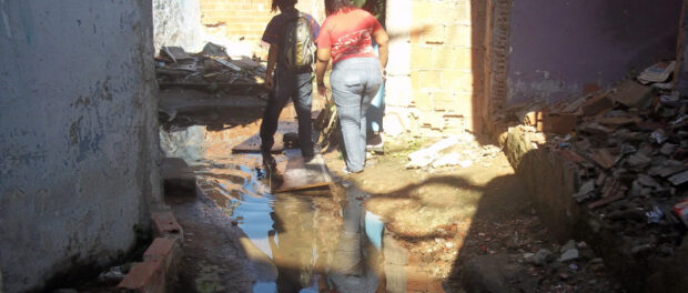 Sewage and stagnant water run between houses