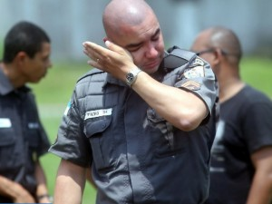 Police officer crying over death of colleague