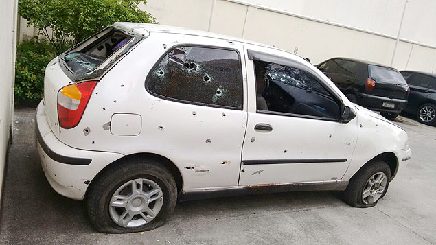 The car in which the five young men were shot at by police and died.