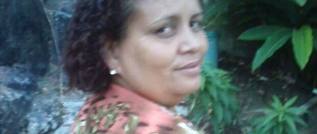 Elizabeth Moura, 41, was with her family at home, sitting on her couch, when she was hit in the neck by a bullet.