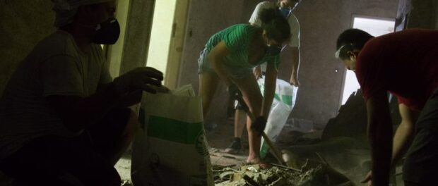 Residents carry out works to improve the building