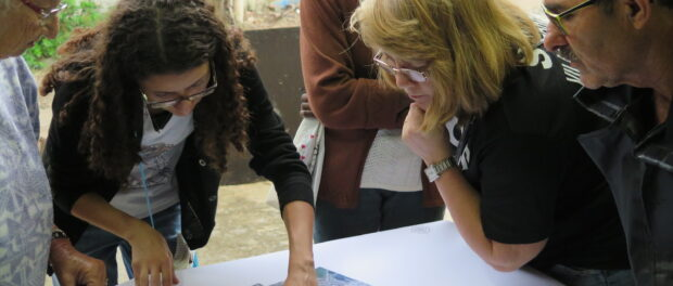 Nathalia explaining Federal University of Rio de Janeiro drone-produced map to fellow resident-resisters