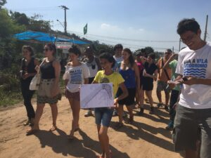 Maria da Penha leads group of residents and activists