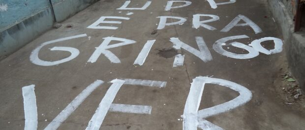 """""""The UPP is for the Gringo to see,"""" written on a street of Complexo do Alemão in August 2014"""