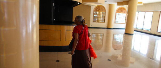 Resident entering the occupation through the former hotel lobby