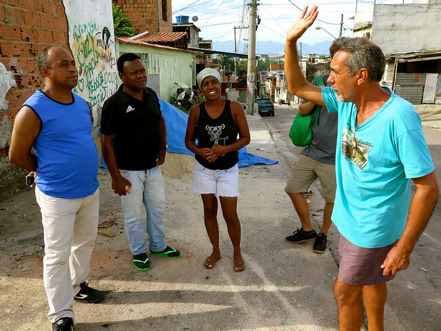 Pica-Pau Neighborhood Association president Irenaldo (left) discusses issues with residents