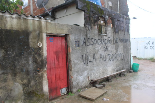 """The front of Sandra Regina's house spells the phrase """"Vila Autódromo NeighborhoodAssociation."""" All of the houses have been renamed in this way. Photo by Miriane Peregrino"""
