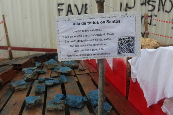 """""""The Vila of All Saints"""" represents Nanã's house as part of the tour of the Evictions Museum. The text pictured was written by Pedro, one of the supporters of the community. Photo by Miriane Peregrino."""