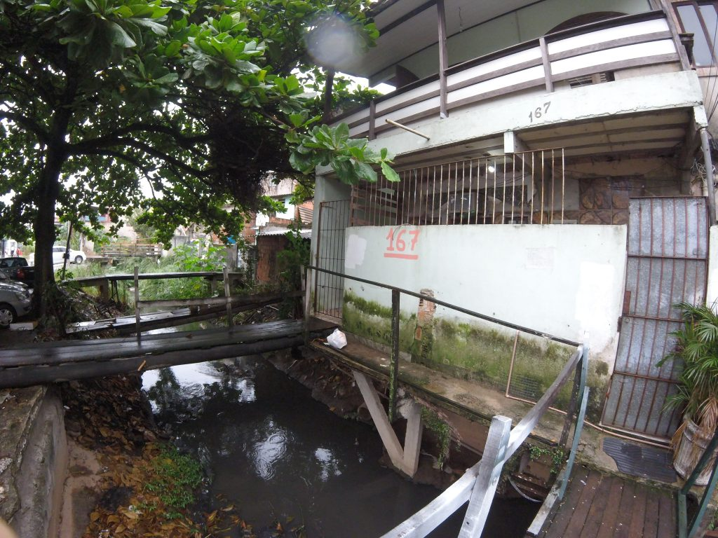 The small stream that leads to Daniel's home was once covered by a concrete bridge until the City demolished it.