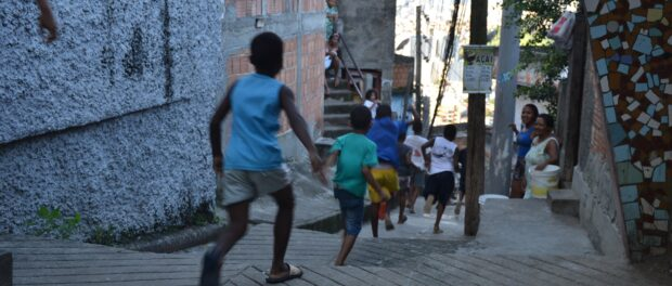 Children running down the streets of the favela