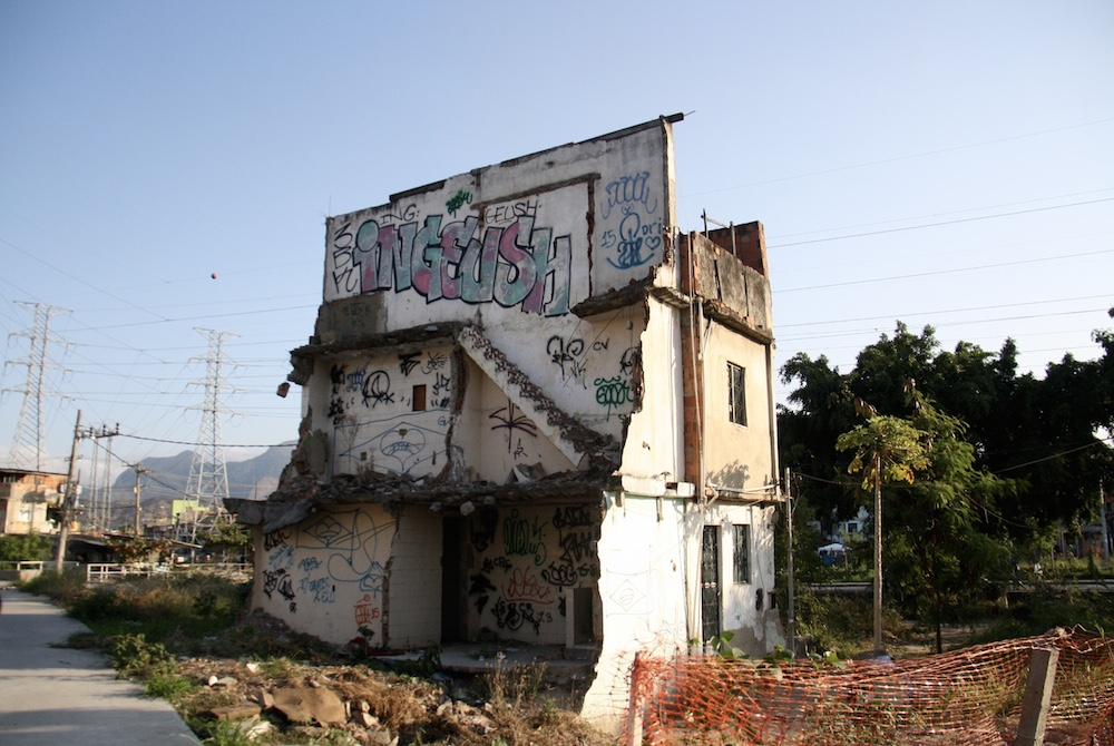 Remaining homes in Beira Rio form an island amidst debris and abandonment where nothing of consequence was ever built.
