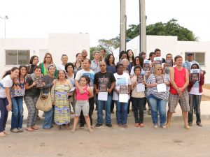 Vila Autódromo residents receive keys to new homes. Photo from Museu de Remoções Facebook page