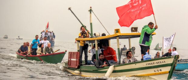 Fishermen and community members protest the pollution of Guanabara bay by oil spills and sewage leaks.
