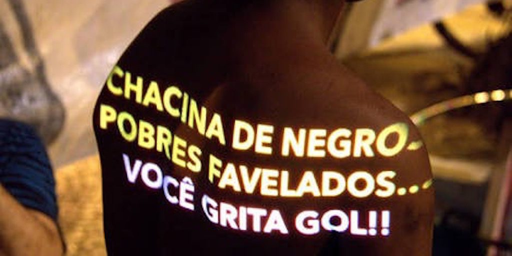 """Massacre of black, poor favela residents and you shout goal!"""