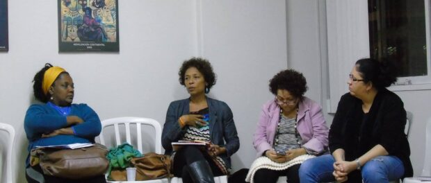 Mônica Sacremento speaks at an event organized by CAMTRA (Casa da Mulher Trabalhadora) in June.