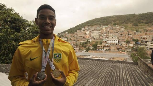 Ygor Coelho with some of his medals. Photo via Associação Miratus Facebook page.