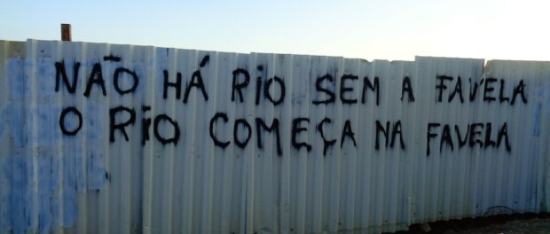 Owner of the last original house standing, Delmo, is responsible for some of Vila Autódromo's protest graffiti. This one reads—There is no Rio without the favela. Rio begins in the favela.