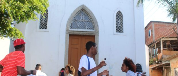Youth from Efeito Urbano perform in front of the church. Photo by Miriane Peregrino