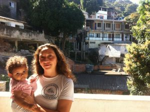 Girasol Comunicações' Natalia Urbina and her daughter stand in front of Babilônia