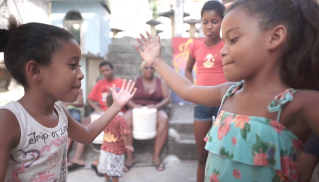 Children practicing jongo. Film still from Jongo Fever