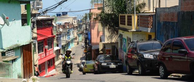 Mototaxi takes passenger up Vidigal street. Photo courtesy of Favela Experience