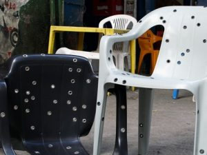 Stray bullet chairs by designer David Elia