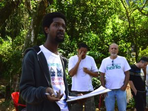 Horto Neighborhood Association President Emerson de Souza discusses the eviction notice on Saturday