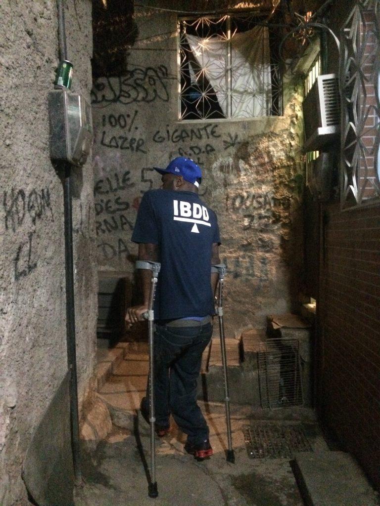 Valdir navigates Rocinha's narrow alleys on crutches