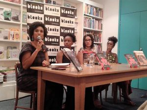 Marielle Franco answers a questions at the Angela Davis book launch. Next to her, from left to right: Jacana Melquiades, Karina Vieira and Ana Paula Lisboa