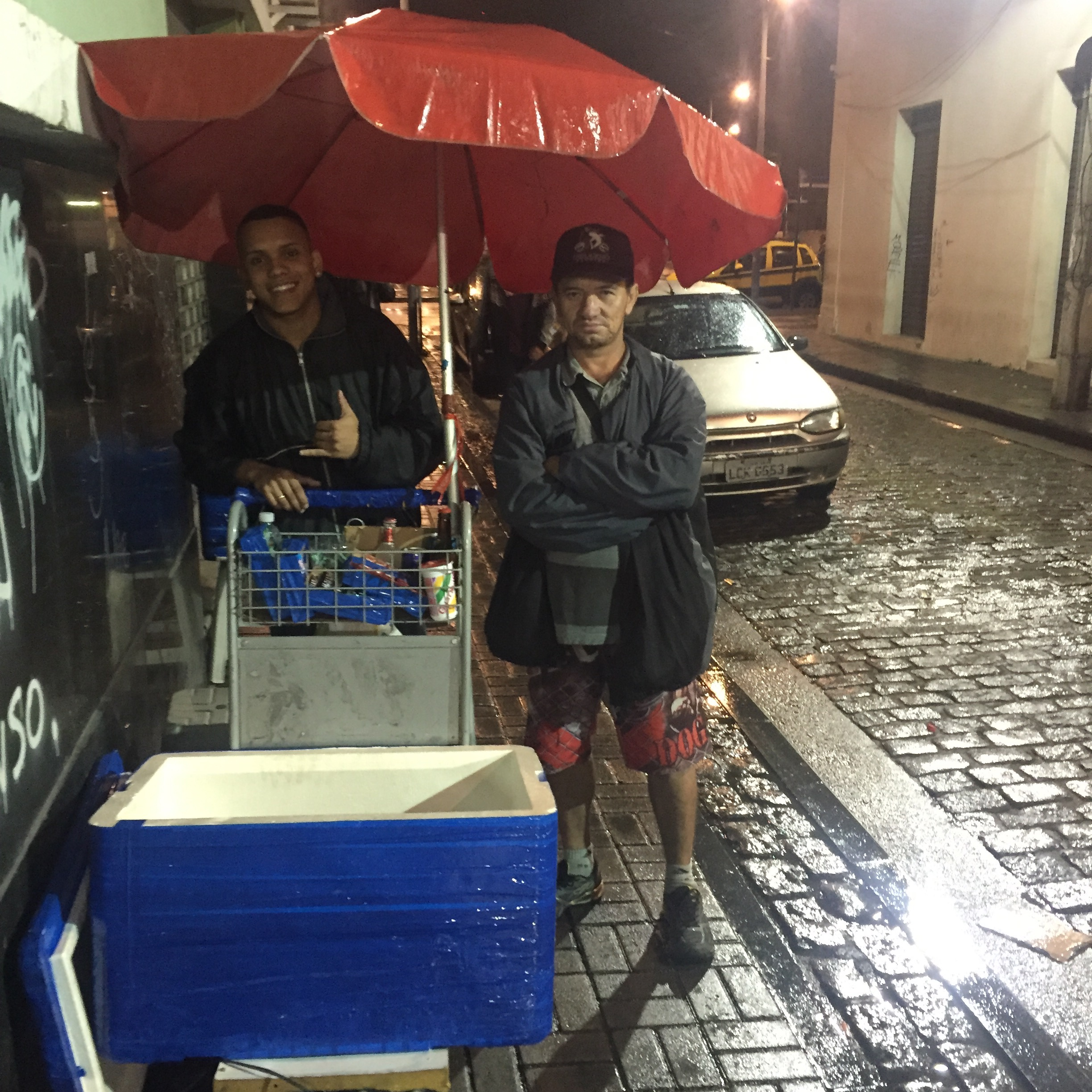 Extended Family Business: Gabriel (left) stores his product in the garage of Francis (right) in the favela of Providência. Francis' wife is Gabriel's fiancee's aunt. Each Monday, Gabriel comes by train to Rio where he meets Francis in Providência and the two make the half hour trek together with their carts to Pedra do Sal.